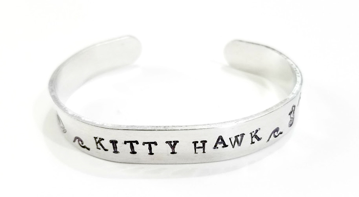 Stamped Bracelets with Outer Banks towns and designs hand stamped.